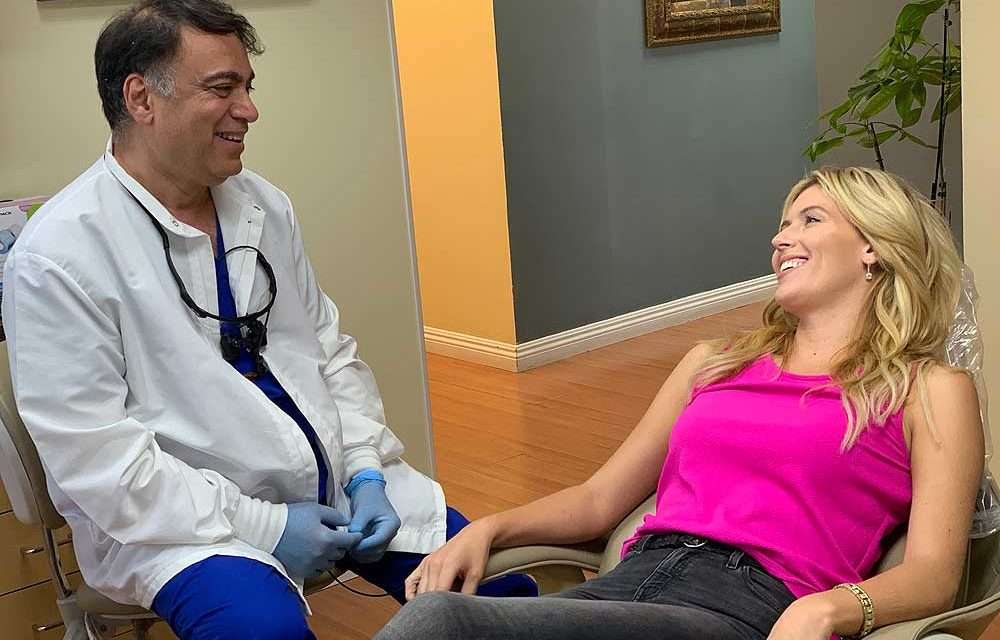 Bruce Vafa DDS with her patient