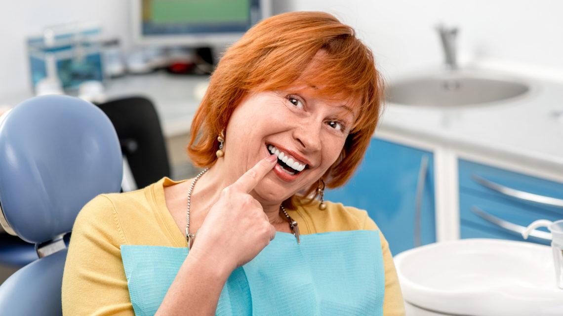 senior women with natural dentures